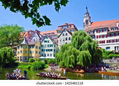 TUBINGEN, GERMANY - JUNE 15, 2017: picturesque old town with colourful half-timbered houses, crossed by the river Neckar. In this image appear Collegiate Church  and Holderlin's Tower.