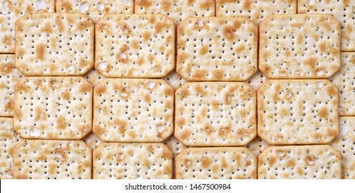 Tuc Original Snack Crackers lies on market table stacked in big pile