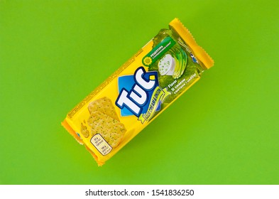 Tuc snack pack on bright green flat background