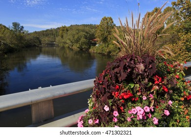 Tuckasegee River, on the bridge in Bryson City, North Carolina, in the summer with pretty flowers on the rails.