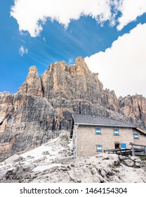 Tuckett Refuge in Madonna di Campiglio (Dolomites in Trentino, Italy) surrounded by beautiful snowy mountain peaks