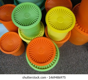 Tucson, Arizona, USA–July 27, 2019: A colorful display of vintage plastic Tupperware food storage canisters beckons collectors at a local antique mall.