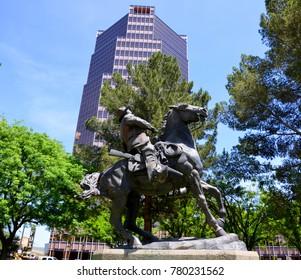 TUCSON ARIZONA APRIL 24 14: El Soldado De Cuera Statue of an 18th century Spanish soldier located in El Presidio Park in Tucson, Arizona. By Buck McCain