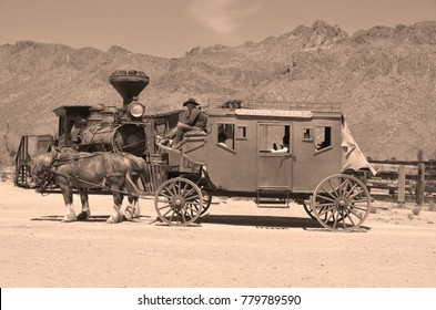 TUCSON ARIZONA APRIL 24: A vintage stagecoach at Old Tucson on april 24 2014 in Tucson Arizona. A stagecoach is a type of covered wagon used to carry passengers and goods inside.