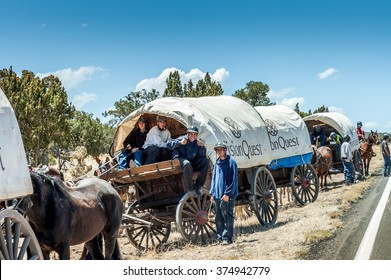 Tucson, Arizona, USA - April 26,2006 : male juvenile traveling on covered wagons drawn by mules over the Western states  Wagon Train trips are operated by the Vision-Quest