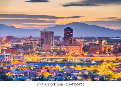 Tucson, Arizona, USA downtown skyline with Sentinel Peak at dusk.