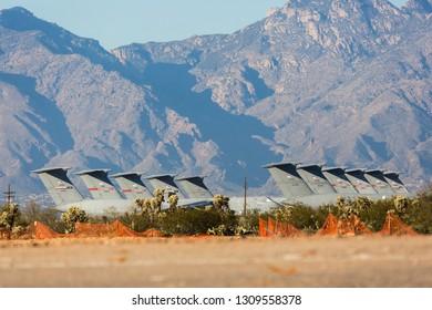 TUCSON, ARIZONA / USA - January 26, 2019: Retired U.S. Air Force C-5 Galaxies lined up at the aircraft boneyard in Tucson, Arizona.
