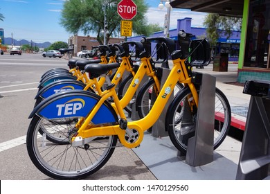 Tucson, Arizona USA - July 23, 2019: Tugo bike share rental program bicycles in a docking station on 4th Ave