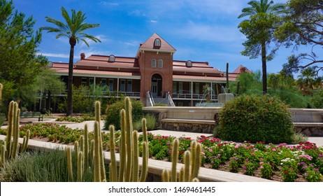 Tucson, Arizona USA - July 28, 2019: University of Arizona Old Main building, 1891, side view with desert landscaping