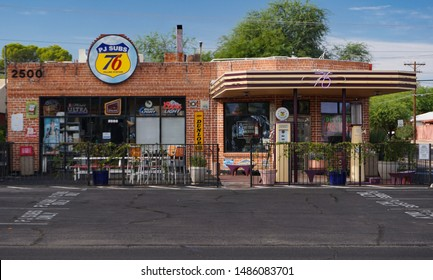 Tucson, Arizona USA - July 28, 2019: An old corner gas station converted to a restaurant on East 6th Street at Tucson Boulevard, features old gasoline pumps, canopy and a brick exterior