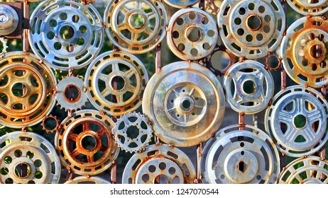 Tucson, Arizona / USA - wall collection of rusted metal hubcaps