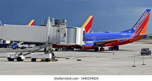 Tucson, Ariz./USA-6/30/19: Southwest Airlines planes parked at Tucson International Airport. Summer storms approach in the background.