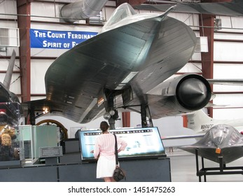 Tucson, Ariz./USA-7/3/11: A woman looks at a decommissioned Lockheed SR-71A Blackbird supersonic spy aircraft on display at the Pima Air Museum.