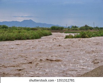 Tucson, Ariz./USA-July 29, 2012: A flash flood caused by a summer cloudburst fills the Rillito River, north of Tucson, with a roiling, muddy torrent.