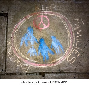 Tucson, AZ, June 21, 2018: Chalk art on sidewalk protesting against the US practice of separating illegal immigrant children from their parents, separating familes