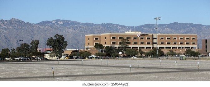 TUCSON, AZ - NOVEMBER 25, 2014: The University of Arizona Medical Center against Santa Catalina mountain range and blue sky as seen from south side.