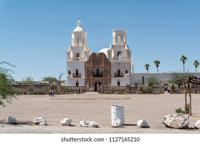 Tucson, AZ, USA - 03 June 2018: catholics visit the Mission San Xavier del Bac. It is a historic Spanish Catholic mission located about 10 miles south of downtown Tucson.