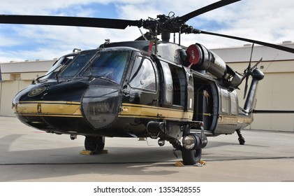 Tucson, AZ, USA - March 23, 2019: A UH-60 Blackhawk helicopter parked on the runway at Davis-Monthan Air Force Base. This UH-60 is operated by the U.S. Customs and Border Patrol (CBP).