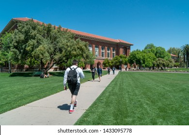 TUCSON, AZ/USA - APRIL 11, 2019: Unidentified Individuals on the campus lawn of the University of Arizona.