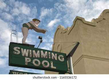Tucson, AZ/USA - August 17, 2018: Vintage neon advertisement at a former hotel showing woman in bikini and the words SWIMMING POOL