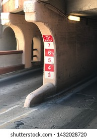 Tucson, AZ/USA - June 20: red and white water level indicator in feet at an underpass