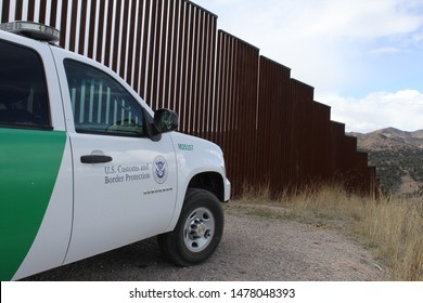 Tucson Sector, Ariz. / US - March 4, 2015: The view looking west along bollard style fencing marking the US Mexico border. 4530