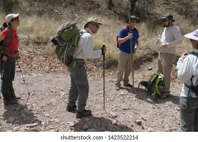 Tucson Sector, Ariz. / US - May 24, 2014: In southern Arizona's dangerous terrain, Samaritans humanitarian volunteers hike to look for injured people; they leave basic supply bags and water.