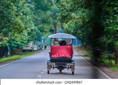 Tuc-tuc on the Angkor Wat complex is popular tourist attraction, Angkor Wat Archaeological Park in Siem Reap, Cambodia UNESCO World