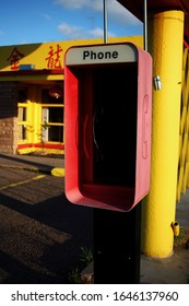 Tucumcari, New Mexico - June 14 2015:  An empty phone booth by a Chinese restaurant on Route 66.