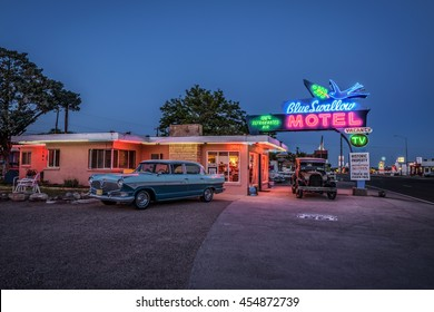 TUCUMCARI, NEW MEXICO - MAY 13, 2016 : Blue Swallow Motel with vintage cars parked in front of it. This building is listed on the National Register of Historic Places as a part of historic Route 66.