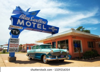 Tucumcari, New Mexico, USA - 04.07.2015: Blue Swallow Motel with vintage car. This famous hotel is listed on the National Register of Historic Places in New Mexico. It is located on route 66.