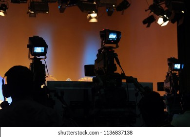 tudio with camera and lights.Recording live talk show at television studio.television studio with camera.select focus.