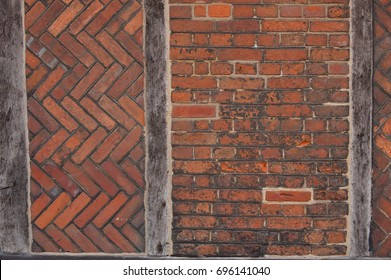 Tudor brick wall with wooden timber supports