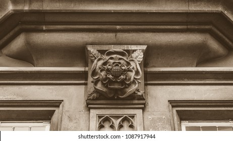 Tudor Rose in Sepia, Architecture Details of old building in Somerset England, sepia tone horizontal photography