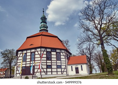 Tudor style country church with a bell tower in Poland