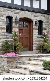 Tudor style house with stone facing and flagstone steps