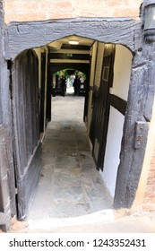Tudor timber frame archway leading to a courtyard. Timber frame archway of a Tudor building leading to an enclosed courtyard.