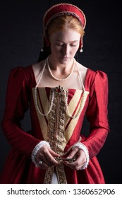 Tudor woman in red dress