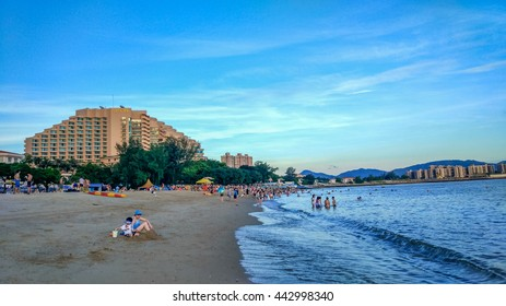 TUEN MUN, HONG KONG - JUNE 25, 2016: People enjoying a sunny day at Golden beach in Tuen Mun. It is the first artificial beach in Hong Kong.