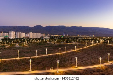 Tuesday, 25 June 2019; Ashgabat, Turkmenistan; Beautiful cityscape, panorama view on the white city at blue mountains with iconic landmarks of the capital of Central Asian state few minutes sunset.