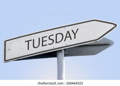 TUESDAY word on road sign