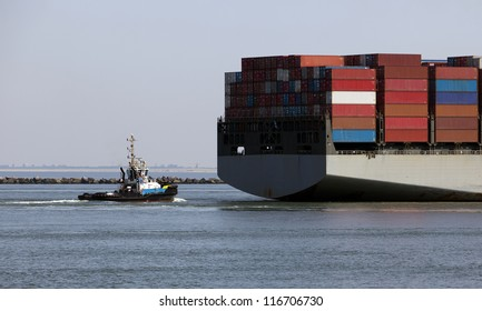 tug behind a containership