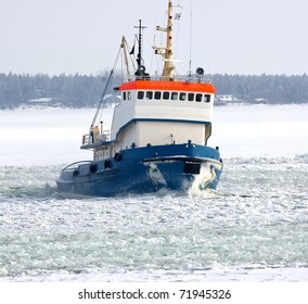 Tug boat breaking ice