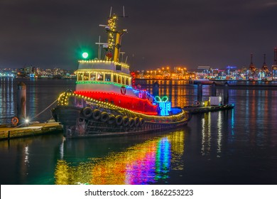 Tug boat decorated and lighted for Christmas and for New Year Eve at Night in Vancouver, Canada.