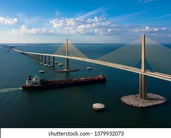 Tug Boat Floats Under The Sunshine Skyway Bridge In St Petersburg Florida