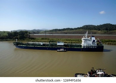 Tug boat and freighter in transit between locks of the Panama Canal