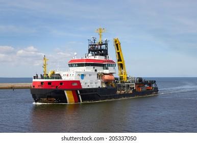 tug boat at an industrial harbor