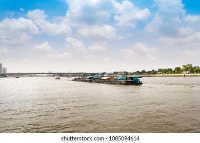 tug boat sand barge on chao phraya river