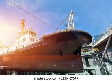 Tug boat under Repair and Maintenance in floating dry dock on Vintage tone