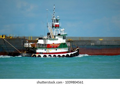 Tug Boats towing a barge background